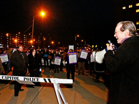 SEIU Local 668 President Tom Herman speaks to those gathered during the Harrisburg #Savethe600 Unemployment Compensation Workers Rally outside the Labor and Industry Building in Harrisburg, Monday, Nov. 28, 2016. Dawn J. Sagert photo