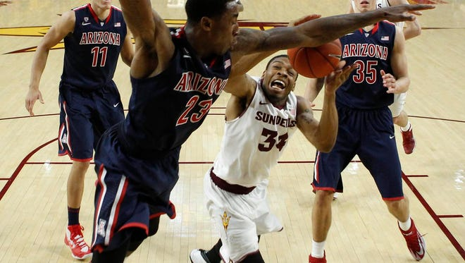 Feb. 14, 2014 -  ASU guard Jermaine Marshall tries to put up a shot as UA's Rondae Hollis-Jefferson defends in the second half in Tempe.