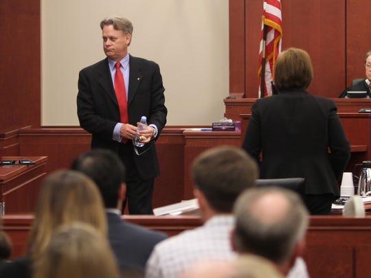 Jay Poston, father of victim, Ryan Poston, looks forward