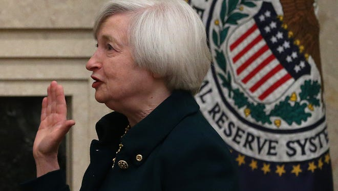 Janet Yellen is sworn in Monday as Federal Reserve chairman at the Federal Reserve Building in Washington.
