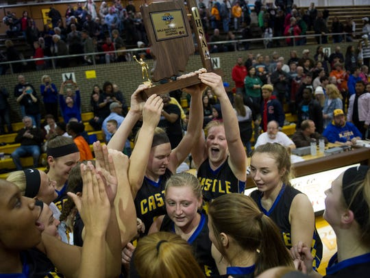 Castle's team celebrates with the Class 4A Central Sectional championship trophy on Saturday night. It marked the Knights' first sectional title since 2014.