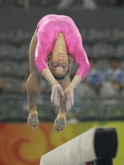 Shawn Johnson performs on the balance beam during training on Aug. 7, 2008, ahead of the Beijing Olympics.