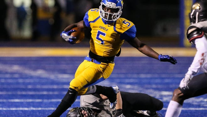 Tupelo's Jaquerrious Williams runs against Northwest Rankin during Friday's Class 6A first-round playoff game.