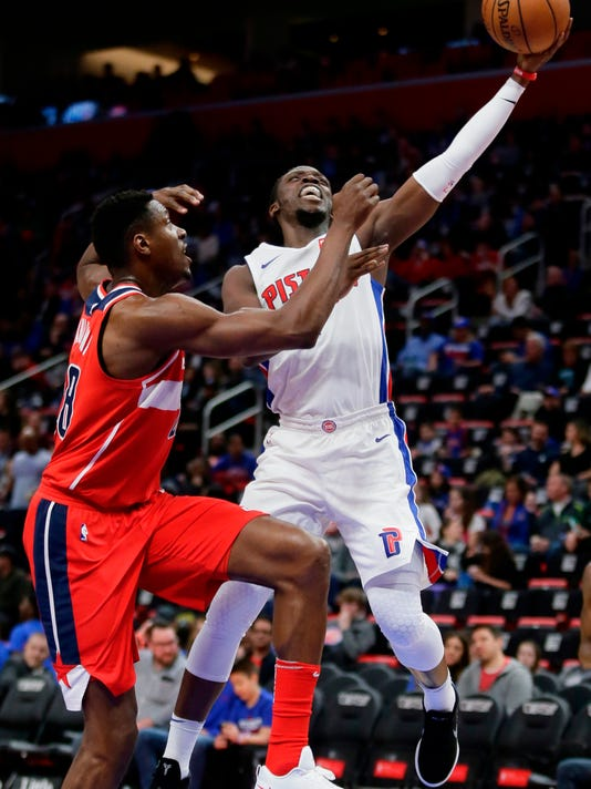 Detroit Pistons guard Reggie Jackson, right, shoots against Washington Wizards center Ian Mahinmi during the first half of an NBA basketball game Thursday, March 29, 2018, in Detroit. (AP Photo/Duane Burleson)