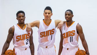 Sep 26, 2016: (From left) Phoenix Suns guard Eric Bledsoe , guard Devin Booker and guard Brandon Knight pose for a portrait during media day at Talking Stick Resort Arena.