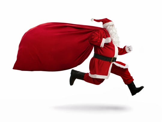 Santa Claus on the run to delivery christmas gifts