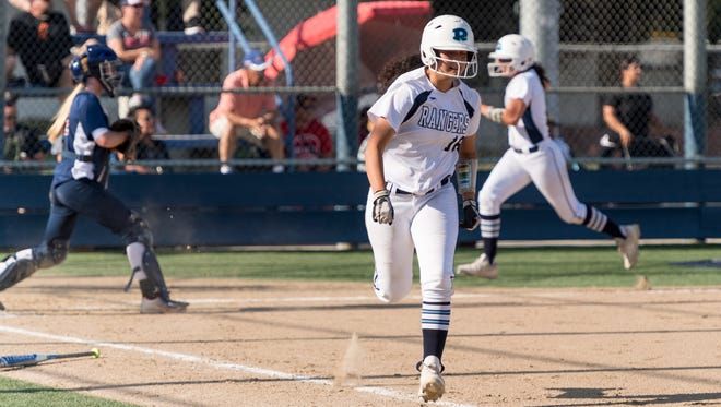 Redwood's AJ Huerta runs out a double that allowed Prya Burns and Emily Ibarra to score against Sanger in a Central Section Division II high school semifinal softball game on Wednesday, May 23, 2018.