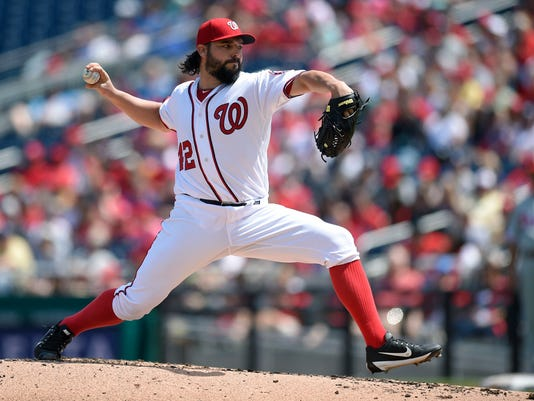 Washington Nationals starting pitcher Tanner Roark delivers a pitch during the second inning of a baseball game against the Philadelphia Phillies, Saturday, April 15, 2017, in Washington. (AP Photo/Nick Wass)