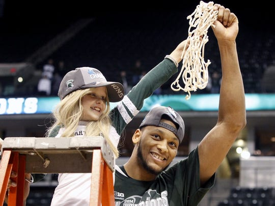 Michigan State center Adreian Payne celebrates the Big Ten Tournament victory over Michigan with Lacey Holsworth on March 16, 2014, in Indianapolis.