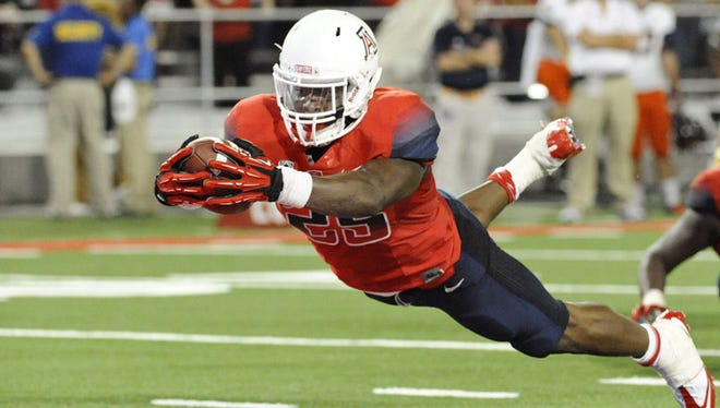 Arizona Wildcats running back KaDeem Carey (25) scores a touchdown that was later called back because of an illegal formation during the fourth quarter against the Texas-San Antonio Roadrunners at Arizona Stadium on Sept. 14, 2013. The Wildcats defeated the Roadrunners 38-13.
