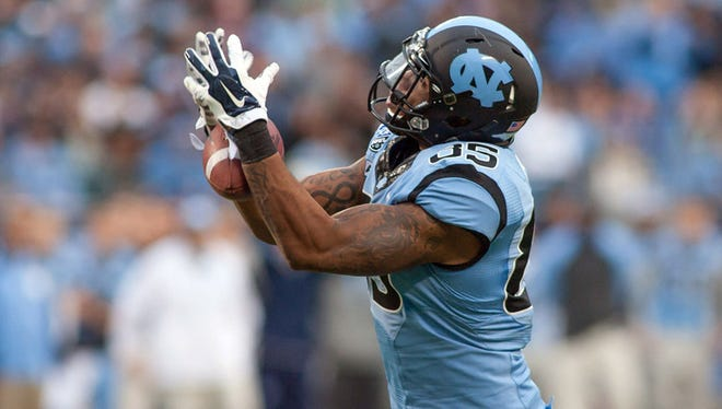North Carolina Tar Heels tight end Eric Ebron (85) tries to catch a pass during the second quarter against the Cincinnati Bearcats at Bank of America Stadium on Dec. 28, 2013.