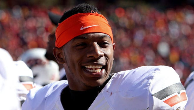 Oklahoma State Cowboys cornerback Justin Gilbert (4) smiles during the third quarter against the Iowa State Cyclones at Jack Trice Stadium on Oct. 26, 2013.