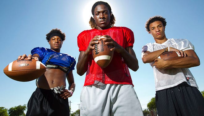 Chandler High players (from left) N'Keal Harry, Bryce Perkins and Chase Lucas open the season against perennial contender Peoria Centennial.