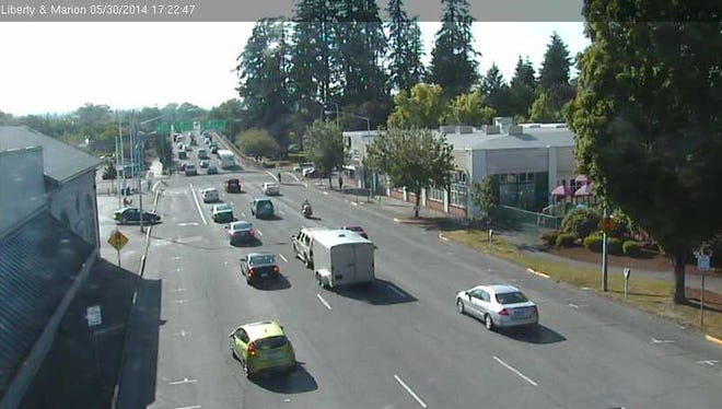 A traffic camera shows the intersection of Liberty and Marion streets NE