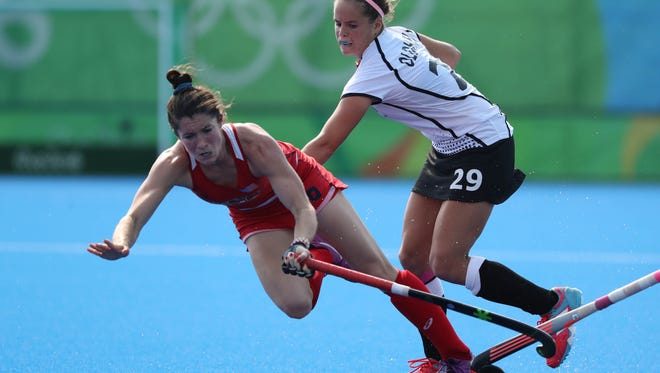 USA midfield Michelle Vittese (9) battles for the ball with Germany forward Pia-Sophie Oldhafer (29)  during a women's hockey quarterfinal match in the Rio 2016 Summer Olympic Games at Olympic Hockey Centre.