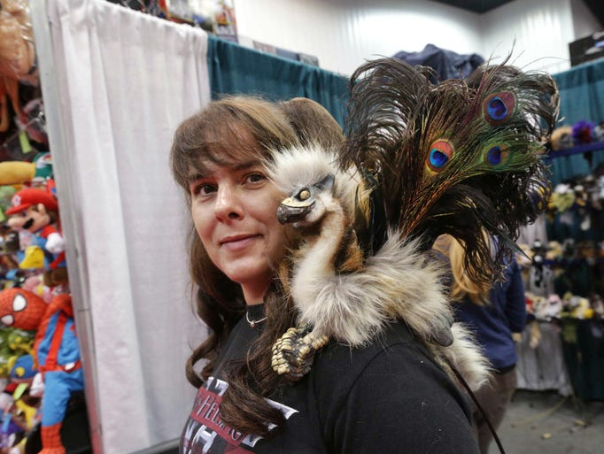 A griffin Cable puppet sits on the shoulder of Shari