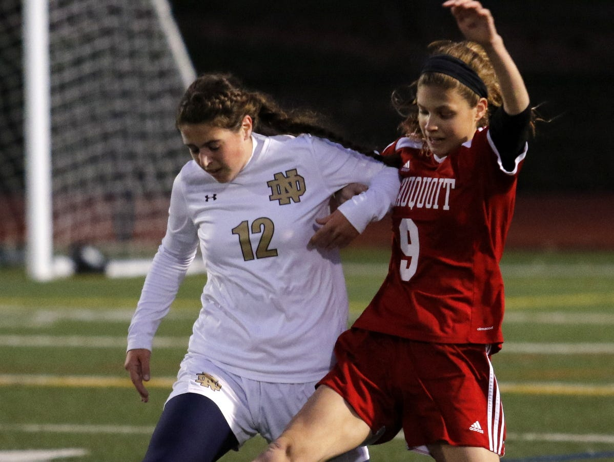 Notre Dame's Victoria Schutrum fights for control of the ball with Sauquoit Valley's Adrianna Grande during Saturday's Section 4 Class C girls soccer quarterfinal in Vestal.