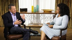 Lance Armstrong, left, was interviewed by Ophrah Winfrey