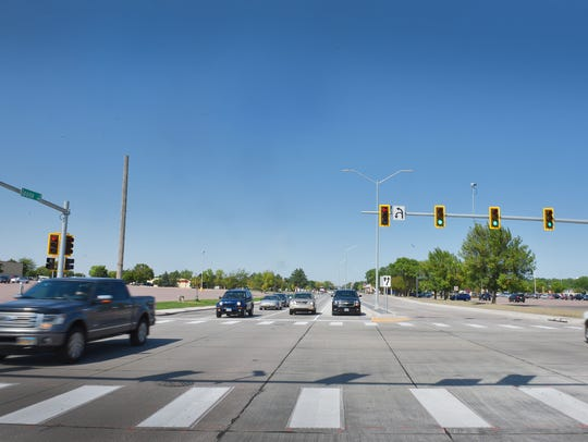 Traffic flows up and down Louise Avenue between 41st