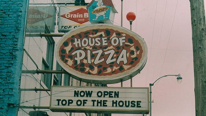 The old sign at House of Pizza.