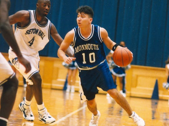 Monmouth guard John Giraldo dribbles in a game against Seton Hall in a 2005 game.