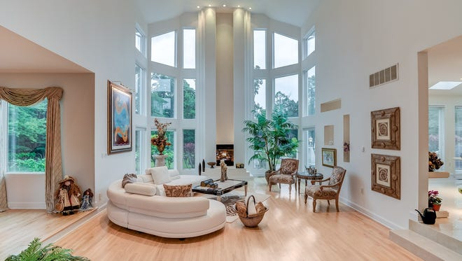 Step inside this Marlboro mansion, which features a jaw-dropping open floor plan and two-story grand reception area.
