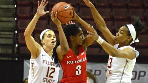 Brittany Brown and Ivey Slaughter double-team a Rutger's player in FSU's big win over the Scarlet Knights.