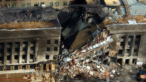 A section of the building above the heavily damaged first and second floors collapsed about 20 minutes after the initial attack.