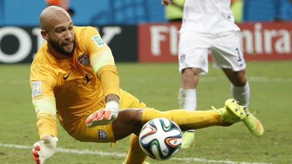 Jun 22, 2014; Manaus, Amazonas, BRAZIL; United States goalkeeper Tim Howard (1) makes a save against Portugal during the second half of a 2014 World Cup game at Arena Amazonia. Mandatory Credit: Winslow Townson-USA TODAY Sports