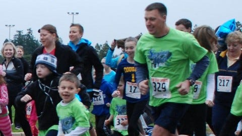 Participants in a previous Spring for Kids Race run toward the finish line.