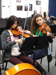 Lindsay Liu and an orchestramate rehearse together.