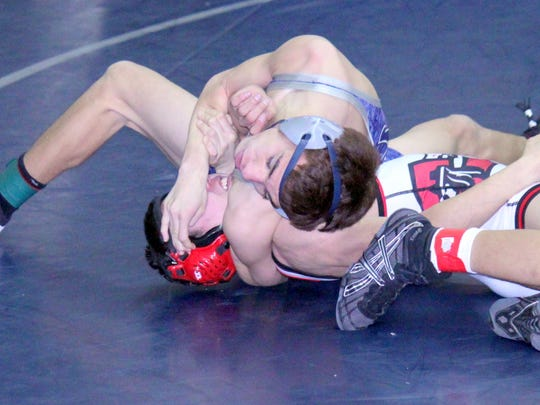 Silver's Zeke Marquez tallied this five-point move to gain an advantage over Cobre's Jose Delgado. Marquez won, 8-6, to claim the district crown Saturday at Silver High.