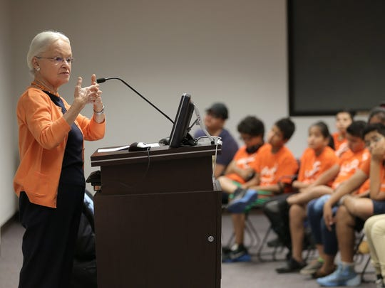 University of Texas at El Paso President Dr. Diana Natalicio speaks in July to children who were graduating from the Higher Opportunities Thrive program at UTEP. The program exposes youths in public housing to university life.
