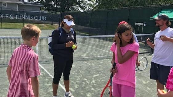 Tennis Hall of Famer Gigi Fernandez signs autographs after a clinic she put on last Friday at York Golf & Tennis.