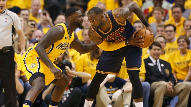 Cleveland Cavaliers forward LeBron James (23) is guarded by Indiana Pacers guard Lance Stephenson (6) in game three of the first round of the 2017 NBA Playoffs at Bankers Life Fieldhouse.