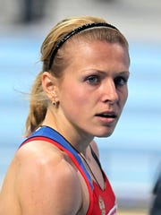 In this March 4, 2011, file photo, Yuliya Stepanova poses in an undisclosed location.