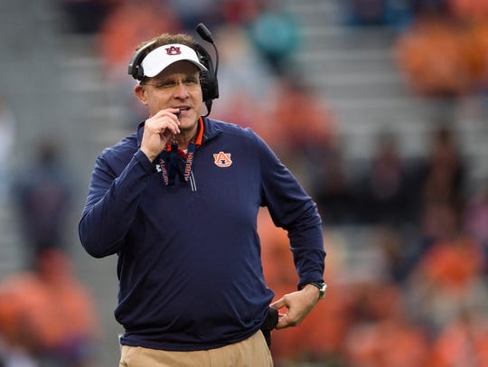 Auburn head coach Gus Malzahn smiles during the Auburn