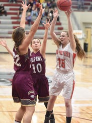 Norfork's Pearl McGowan passes over two Alpena defenders