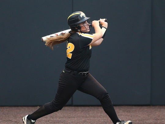 Hanover Park's Jessica Miller hits a 2 RBI triple in