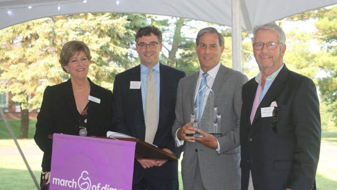 At annual dinner and putting challenge, $280,000 was raised for the March of Dimes, while Mack-Cali CEO Mitchell E. Rudin, second from right, was honored. He is pictured from left to right with Carol Roberts, March of Dimes North Central New Jersey Market; Chris Marx, Savills Studley, and event co-chairman Geoffrey Schubert, CBRE.