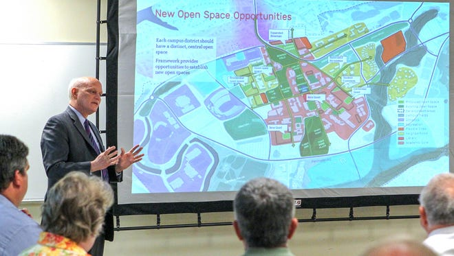 Consultant Greg Havens of Massachusetts presents a study of Clemson University growth, at a public meeting at Clemson City Hall on Monday.