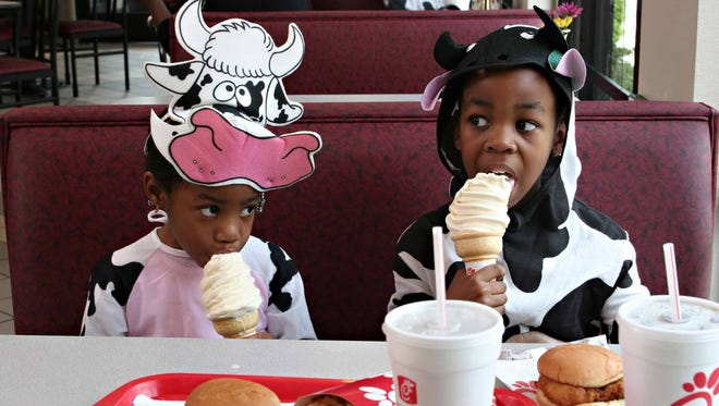 "For sporting cow spots, waving a cow bell or dressing ""udderly crazy,"" customers will be rewarded Tuesday with free food at Chick-fil-A restaurants nationwide."