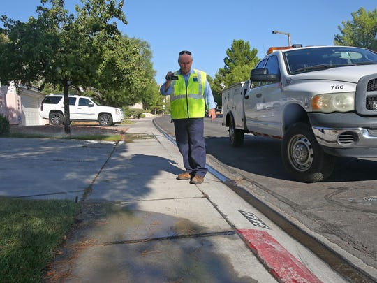 Las Vegas water cop Perry Kaye documents water flowing from a residential sprinkler onto pavement. Unlike Las Vegas, Coachella Valley water providers don't employ water cops to enforce restrictions.