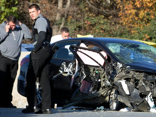 State Police surround a car which crashed into a tractor-trailer after the car's driver was apparently fleeing police on I-83 southbound, north of the Emigsville Exit Tuesday, Nov. 15, 2016. The coroner was called to the scene. Bill Kalina photo