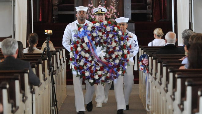Quincy's Naval Operations Support Center honor guard members, from left, Kenneth Williams, Lt. Commander Ryan Seggerty, and Christopher Orlande carrying the presidential wreath to the cypt of President John Quincy Adams during a wreath laying ceremony at the United First Parish Church in Quincy on Thursday, July 11, 2019. Tom Gorman/For The Patriot Ledger
