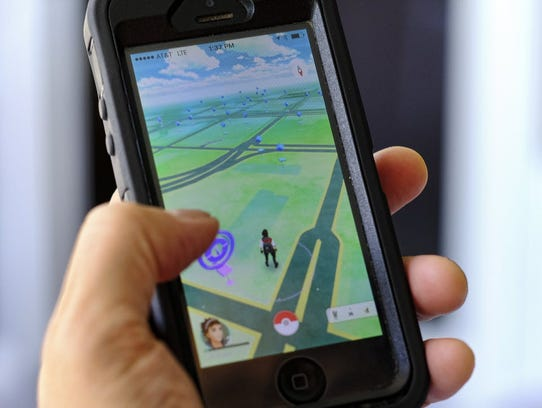Pokemon Go is displayed on a cell phone in Los Angeles.