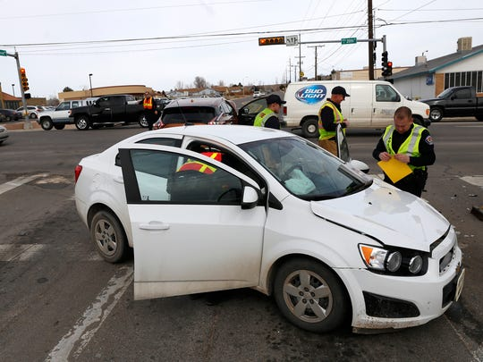 One of the vehicles involved in a two-car injury crash Thursday is pictured at the intersection of the East 20th Street and Sullivan Avenue in Farmington.