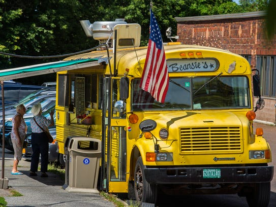 Patrons place an order at Beansie's Bus at Battery