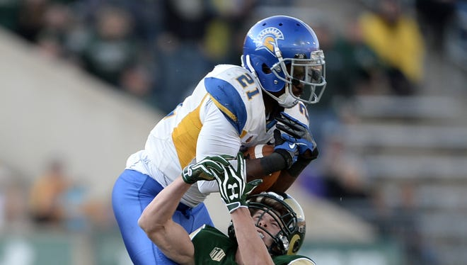 San Jose State Spartans cornerback Bene Benwikere (21) intercepts a pass intended for Colorado State Rams wide receiver Thomas Coffman (2) in the fourth quarter at Hughes Stadium.