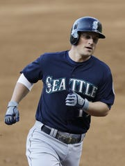 The Mariners' Kyle Seager runs the bases after hitting a grand slam off Indians starting pitcher Trevor Bauer during the third inning Wednesday.